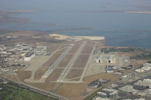 Moffett Federal Airfield. On left of runways, NASA Ames, Hangar One. On right, Hangars Two and Three.